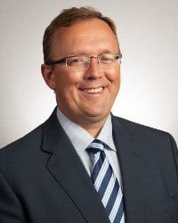 Brian Taylor, AuD <br>Editor-In-Chief