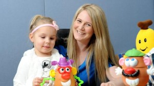Sheridan Flint with Isabella, one of her young patients.
