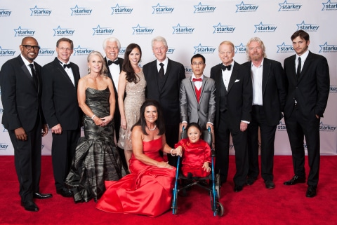 Honorees and presenters from the 13th annual So the World May Hear Gala pose with Bill and Tani Austin, of the Starkey Hearing Foundation. In back, from left, are Forest Whitaker, Dennis Hansen, Leslie Hansen, Bill Austin, Barbara Bush, President Bill Clinton, Xiao Mo, Jimmy Walker, and Sir Richard Branson; in front row are Tani Austin and Angel Chun Li Zhao Photo: Starkey Hearing Foundation