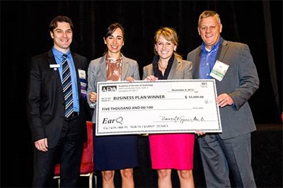 Pictured from left are Brian Urban, president of ADA; competition winners Rachel Magann Faivre and Liz Tusler; and Ed Keller, president of EarQ.
