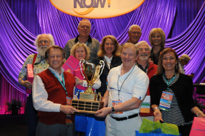 The perennial champion Phonemic Regressives celebrating after last year's victory.  Hoisting the trophy  are Jay Hall, at left, and Frank Musiek. Behind them from left, are Bill Carver, Susan Boyle, Steve Armstrong, Krista Traynor, Wayne Staab,  Bob Traynor, Cindy Compton-Conley, and Georgine Ray.