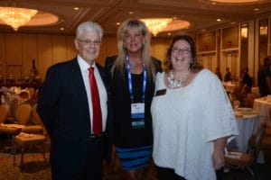 Julia Beall-McKelvey, center, with Tom Higgins, president of IHS, and Kathleen Mennillo, executive director.