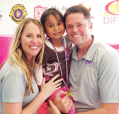 Kristi and Justin Osmond with 5-year-old Daniella, who received hearing aids thanks to the Olive Osmond Hearing Fund.
