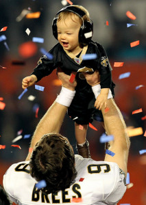 Drew Brees and Son at Super Bowl XLIV. Courtesy Vh1.com