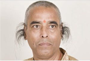 Figure 3. The world's record length for ear hair is held by Radhakant Baijpai, an Indian grocer. The last recorded measurement was almost 10 inches long. (Photo from Weirdlife).