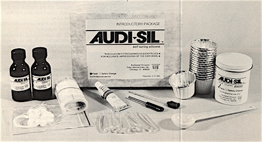 Figure 3.  Audi-sil instant earmold material.  The kit contains enough for 16 ear molds.  It includes a jar of silicone putty, scoop, tube of accelerator, cement, sealer, pre-formed tubing, tube puller, earmold drill, pre-tied cotton blocks, cups, storage envelopes, and instructions.
