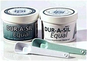 Figure 5. Economy kits of Dur-A-Sil ear impression material in 20 Shore A hardness. Unlike other addition silicones, this used a wax, rather than oil, release agent.