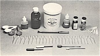Figure 2.  Insta-mold kit containing everything to make an on-the-spot earmold.  Insta-mold mix, hardener paste, hand lotion, insta-cement, applicators, core drill, plunger, tube threader, pre-formed tubing, measuring spoons, packing tool, instal-seal Kote.