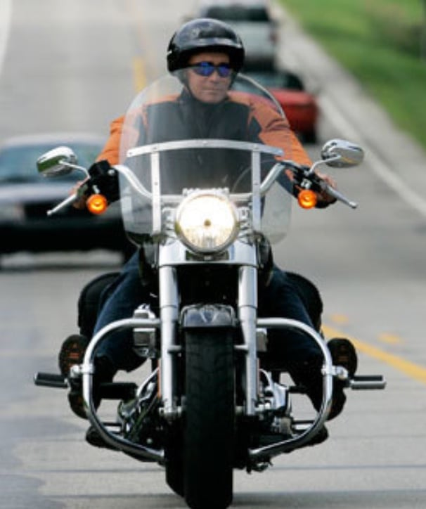 Former Indiana Governor Mitch Daniels riding his custom-built Harley.